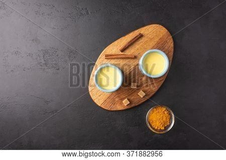 Two Ceramic Blue Cups With Traditional Indian Masala Chai Tea With Sugar On Cutting Board. Top View