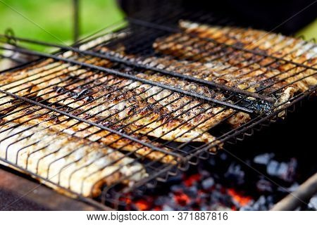 Grilled Fish Mackerel, Cooked On The Grill In The Open Air Flow