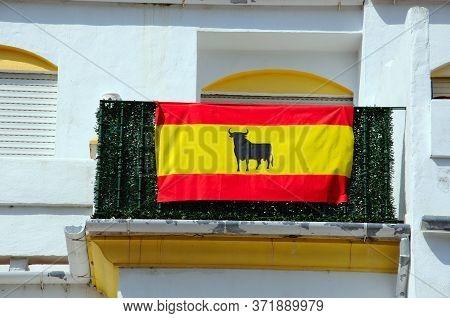 Spanish Flag On Balcony, Benahavis, Costa Del Sol, Malaga Province, Andalucia, Spain, Europe.