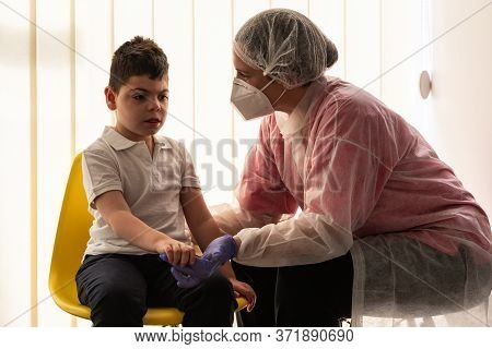 A Physical Therapist Or Nurse Is Talking To And Caring For A Young Child With Multiple Disabilities