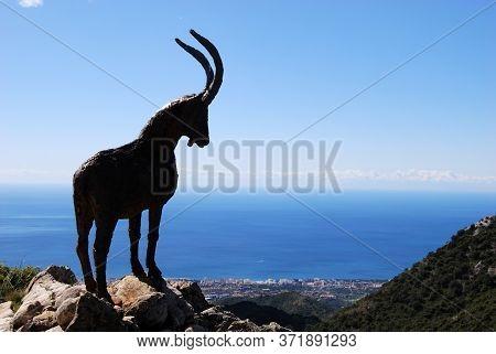 Silhouette Of A Goat Statue Overlooking The Coast At The Refugio De Juanar, Near Marbella, Costa Del