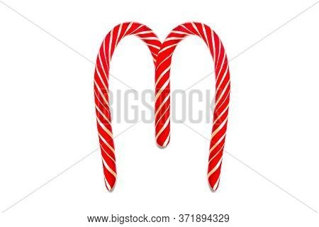 Symbol M Created From Festive Decorative Red Candy. M Holiday Text Made From Red Candy Cane.