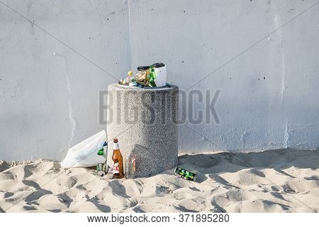 Gydnia, Poland- 09 May 2020; Garbage On The Beach In An Overfilled Bin. The Concept Of People Litter