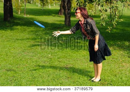 Young Woman With Frisbee