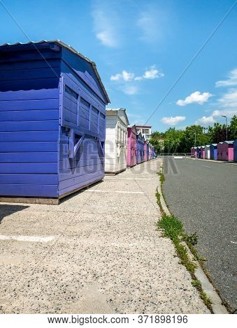 Colored Small Wooden Houses Used As Food Stands In Children's Wo