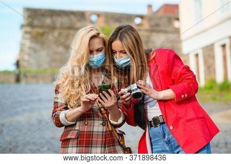Happy Girls Traveling Together In Europe During Pandemic. Stylish Women Walking In Street. Girls Tak