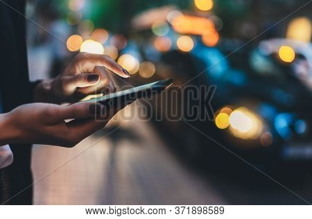 Close Up Female Hand Calling Taxi With A Smartphone App., Businesswoman Using Cellphone With Yellow