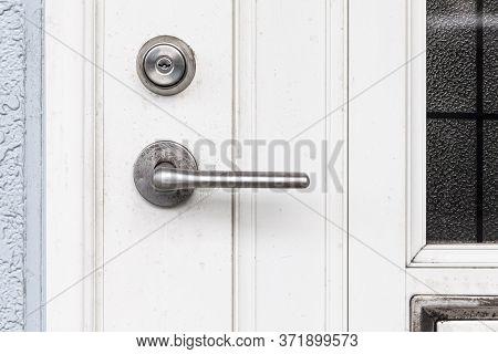 Entrance Door Handle Close Up. Lock And Handle On The Door. Reinforced Door Lock. Doorknob At A Whit