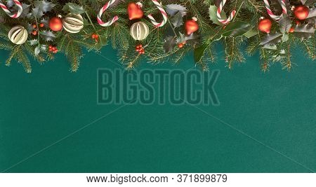 Creative Christmas Flat Lay On Green Paper With Red Decorations, Plenty Of Copy-space. Natural Fir A