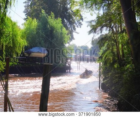 Lush Vegetation, Motor Boat On A Fast River. Tigra Delta In Argentina, Canals And River System Of Th