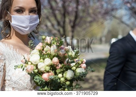 Bride And Groom In Protective Masks. Wedding During The Period Of Quarantine And Pandemic Covid 19-2
