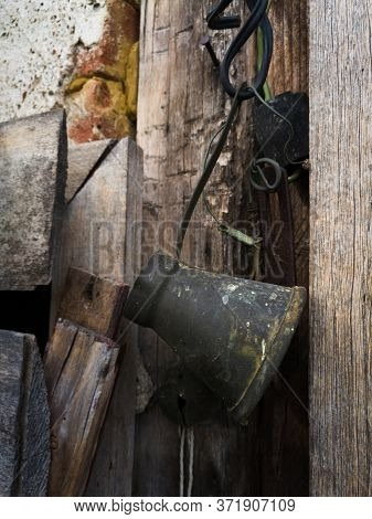 An Old Oxidized Cezve Hung From A Wire. A Cezve Is A Small Long-handled Pot With A Pouring Lip Desig