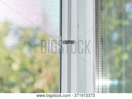 A Close-up On A Plastic Window With A Mosquito Net, Fly Screen, Insect Barrier To Protect The House