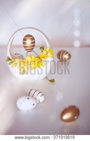 Easter Golden Stripy Egg With Polka Dots And Yellow Freesia Flower, Great Design For Any Purposes. I