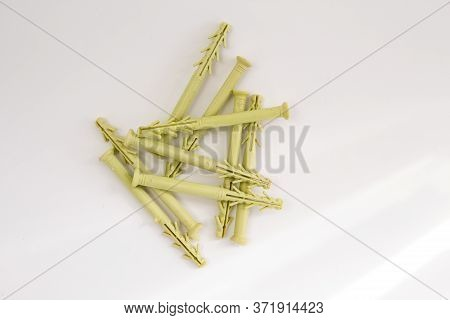 A Yellow Dowels On A White Background
