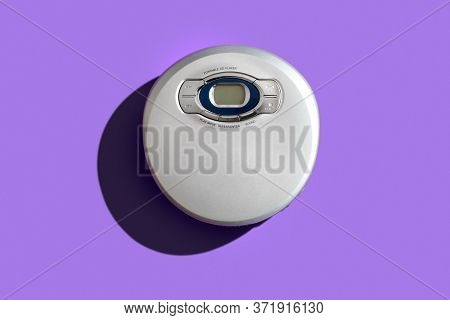 Old Vintage Portable Cd Player On Color Background.