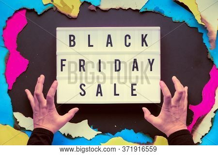 Lightbox Text Black Friday Sale In Burnt Paper Hole In Pink, Purple, Blue And Yellow Vibrant Colors.