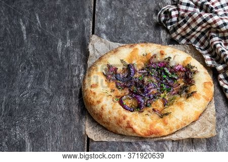 Red Cheddar  And Balsamic Red Onion Flatbreads On Wooden Table