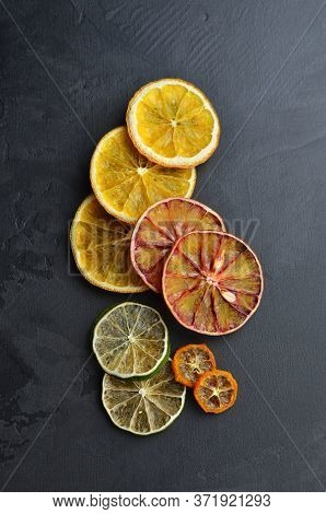Creative Layout Made Of Sundried Citrus Slices. Christmas Composition.