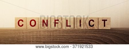 Conflict Word On Wooden Cube. Conflict Of Interests Solution Compromise Business Concept