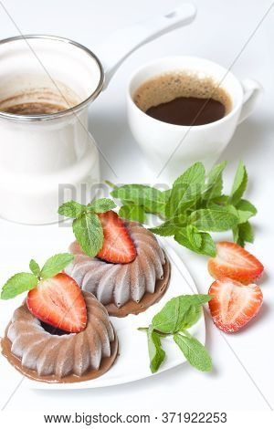 Chocolate Fudge Garnished With Half A Strawberry With Petals. Garnished With Sprigs Of Mint And Stra