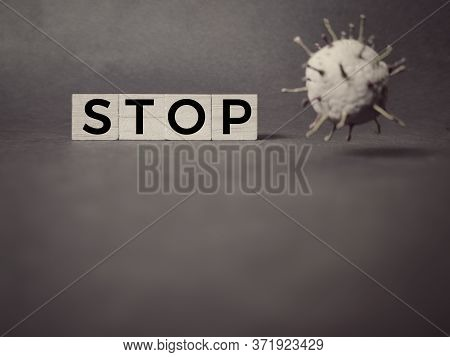 Healthcare Concept - Stop Text On Wooden Blocks In Vintage Background. Stock Photo.