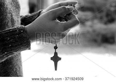 Young Lady Hand Holding Rosary Beads With Jesus Christ Holy Cross Crucifix On Black And White Backgr