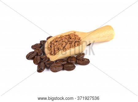 Freeze Dried Instant Coffee In Wooden Spoon And Roasted Coffee Beans On White Background