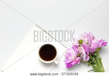 Cup Of Black Morning Coffee, Blank Clean White Notepad Album, Beautiful Pink Peonies Flowers On Gray