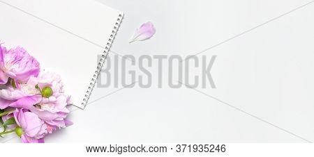 Blank Clean White Notepad Album, Beautiful Pink Peonies Flowers On Gray Background. Top View Flat La