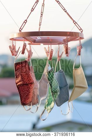 Hand-made Face Masks Made Of Fabric Hang Over The Window Of The Room. Washable And Reusable, Can Be