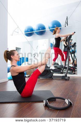 Aerobics pilates gym women group with crosstrainer