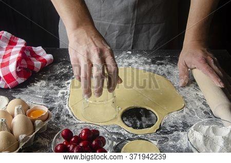 A Man Prepares A Dessert. The Cook Prepares A Berry Pie