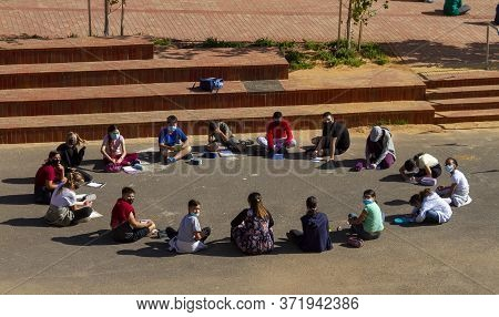 Israel. Rishon Le Sion. 06/05/2020. School Lessons Are Held On The Street. All Students Are Masked.