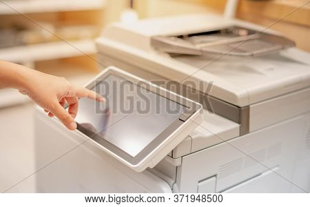Female Hand Pressing The Touchscreen Monitor Of The Copy Machine For Copy A Paper Document, Scanner