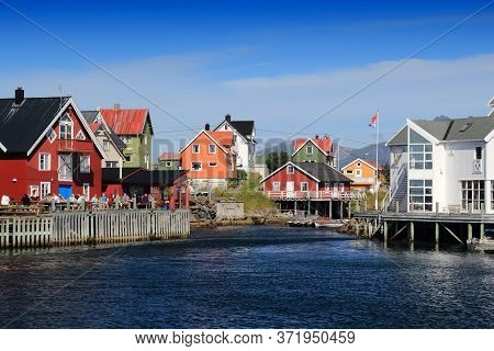 Henningsvaer, Norway - July 29, 2015: People Visit Henningsvaer Fishing Town In Lofoten Islands, Nor