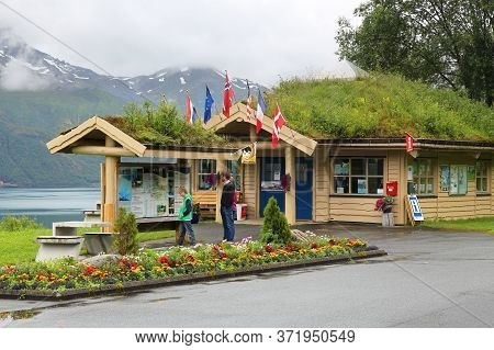 Svartisen, Norway - July 25, 2015: People Read A Tourist Information Board In Svartisen, Nordland Re