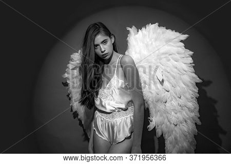 Beautiful Woman Posing With Angel Wings. Young Woman In Angel Costume. Happy Valentines Day. Fallen