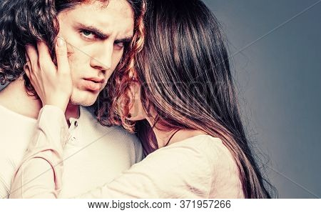 Attractive Young Couple Hugging Each Other On Grey Background. Young Man And Woman In Cuddle. Young