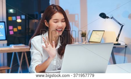 Young Asian Business Woman On Video Conference Call, Using Laptop Computer Work Late Night. Remote M