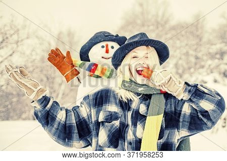 Snowman With Funny Carrot Nose With Fun Girl. Fashion Portrait Of Young Model Girl Indoors With Chri