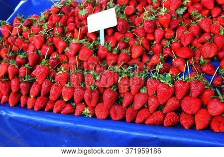 Red Ripe Strawberries. Lot Of Ripe Red Strawberries Are On Sale. Showcase Of The Retail Market Of Fr