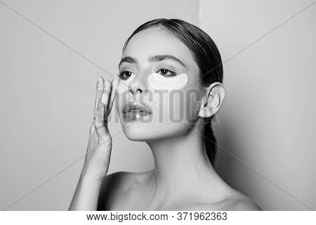 Portrait Of Beauty Woman With Eye Patches. Woman Beauty Face With Mask Under Eyes. Beautiful Female