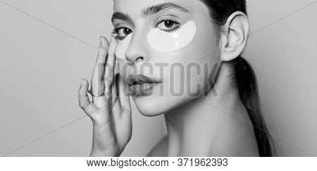 Beauty Girl Face With Flakes Under The Eyes. Womans Flakes. Patches Under Close Eyes For Woman. Youn