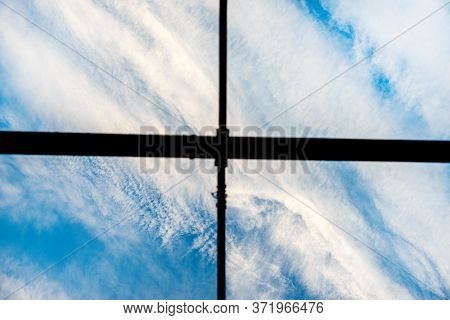 The Division Into Four Parts. Blue Sky With Cirrus Clouds Floating Diagonally.