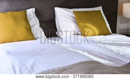 Double Bed In Modern Hotel Room. Accommodation.