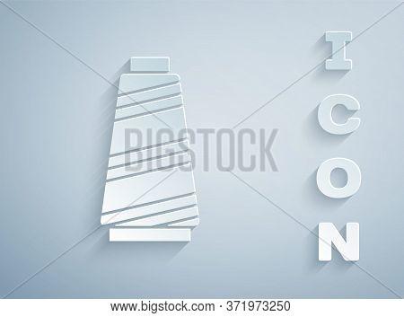 Paper Cut Sewing Thread On Spool Icon Isolated On Grey Background. Yarn Spool. Thread Bobbin. Paper