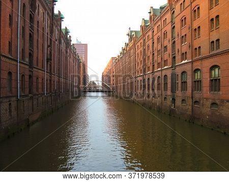 The Warehouse District Speicherstadt During Winter In Hamburg, Germany. Warehouses In Hafencity Quar