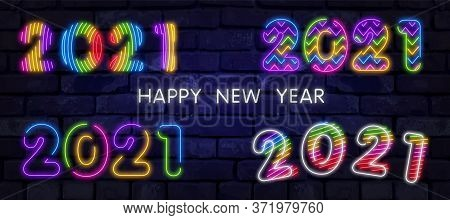 Big Set Of Colorful Neon 2021 Happy New Year Neon Banner. Realistic Bright Neon Billboard On Brick W