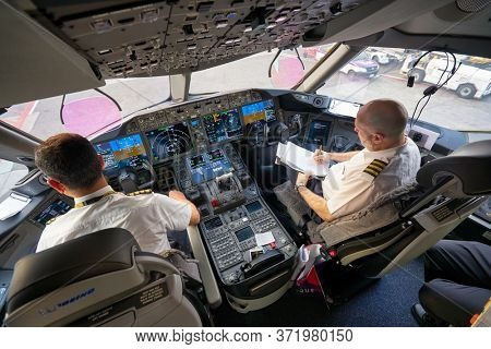 BANGKOK, THAILAND - CIRCA JANUARY, 2020: interior shot of Etihad Airways Boeing 787 Dreamliner cockpit at Suvarnabhumi Airport.